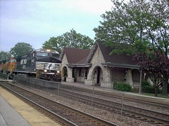 Westbound NS /BNSF unit coal train speeding past the Metra Stone Avenue commuter rail station. La Grange Illinois. May 2007.