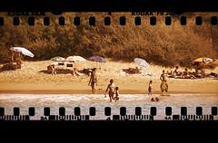 Old days at the beach (iko) Tags: sea mer texture film beach girl swim sand kodak corse negative bikini parasol vegetation swimsuit ajaccio fille plage maillot mditerrane baignade ngatif