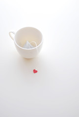 Just Waiting for You (yoshiko314) Tags: red cup heart tea empty teacup teatime teabag whiteground onthetable tableshot d60 55mmf28aismicro