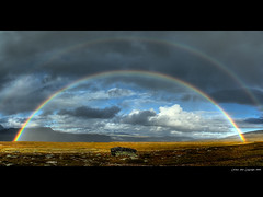 A gate of color (Rob Orthen) Tags: autumn sky panorama fall norway clouds landscape norge rainbow nikon rocks europe d70 hiking august rob lapland scandinavia hdr tundra maisema lappi syksy thenorth norja sateenkaari regnbge taivas vaellus photomatix elokuu tonemapping hdrpanorama orthen roborthenphotography