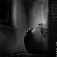 A Stranger in my Place (Meister Des Zirkuss) Tags: bw white selfportrait black film darkroom digital photomanipulation dark nose mirror eyes noir place darkness mask theatre room grunge evil scratches stranger grudge leaking andrei osman depressive opressive meisterdeszirkuss pourking