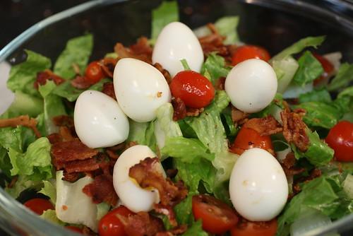 quail egg and bacon salad