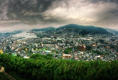 Nagasaki (The Other Martin Tenbones) Tags: city autumn mountain japan clouds canon cityscape fisheye hills desaturation nagasaki hdr 400d