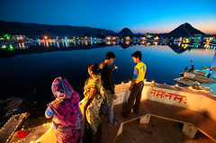 The Holy Lake II ( Poras Chaudhary) Tags: ladies india lake boys mobile evening twilight nikon pushkar saree d3 rajasthan namah 1424mm
