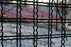 Black undulating wire fence