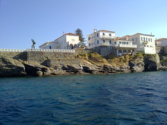 white houses above sea and the 'missing sailor'- statue (dimitra_milaiou) Tags: city blue sea summer sky house castle statue rock swimming island greek grey europe day waves view balcony aegean hellas visit greece hora summertime chora andros cyclades dimitra hellenic  kyklades   aigaio    plakoyres milaiou