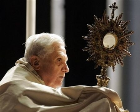 Pope Benedict XVI holding the Eucharist by Christus Vincit