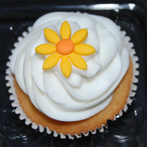 red, orange and yellow Happy Birthday cupcakes yellow flower