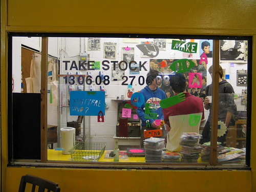 Take Stock window, illustrations by Jay Cover