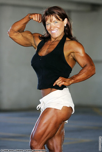 Lisa Aranda Female Bodybuilder Flexes Biceps; Shows Legs