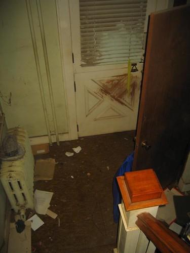 The damaged front door