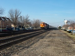 Eastbound BNSF Railway unit coal train slowly approaching the Prairie Avenue railroad crossing. Brookfield Illinois. December 2006.