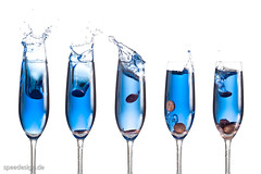 Blue Splash (achimschrepfer.com) Tags: blue color water glass coin coins splash sekt highspeed sektglas spritzer glaeser muenze strobist