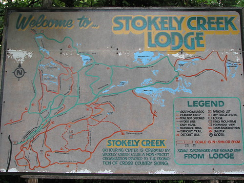 Stokely Creek Lodge sign and trail map