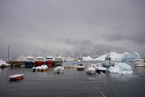 Boats anchored in Uummannaq - an area affected by climate change