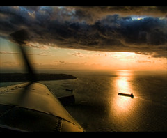 Golden Flight (ecstaticist) Tags: ocean sunset sky cloud reflection plane harbor ship pacific aircraft wave aerial casio airline otter shipping hdr strait copilot propellor hdri floatplane photomatix tonemapping harborair georhia exf1