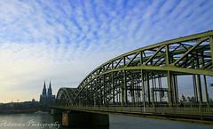 ~Hohenzollern  Bridge~ (Adettara Photography) Tags: blue sky cloud river cityscape angle pov north perspective cologne wideangle kln yesterday rhine 2009 soe klnerdom cubism chatedral 10mm blueribbonwinner hohenzollernbrcke rhinewestphalia cherryontop supershot golddragon mywinners abigfave canoneosdigitalrebelxti worldbest anawesomeshot ultimateshot infinestyle diamondclassphotographer flickrdiamond explore357 theunforgettablepictures brillianteyejewel betterthangood theperfectphotographer adettara magicdonkeybest ~hohenzollernbridge~
