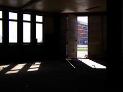 An open door (Eva the Weaver) Tags: light sunlight open garage demolition patches lindholmen patchesoflight disjoint