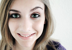 unsymmetrical glory~ (emily oberlin) Tags: green smile face eyes purple teeth dimples eyebrows unsymmetrical