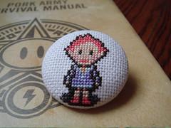 Kumatora button (benjibot) Tags: crossstitch crafts videogames button gba mother3