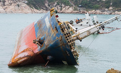 A stranded ship - Hong Kong Cheung Chau  (KL.Lau  ) Tags: ocean old travel blue red sea summer sky white abandoned beach broken nature water metal landscape island hongkong coast boat big sand rust marine industrial ship crash accident steel rusty wave sunny vessel nobody cargo shipwreck shore maritime transportation disaster beached coastline nautical hull sunken aground wreck  stranded trawler ruined ashore cheungchau