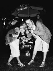 Camera Hungry Fans at V Festival 2008, Sydney (pj_in_oz) Tags: blackandwhite bw film festival candid livemusic sydney saturday australia flashphotography nsw fans musicfestival afterdark centennialpark iso1600 canonef24105mmf4lisusm canonllens thequeensofthestoneage vfestival2008 29march2008 cameracanoneos30 fujifilmneopan1600professional