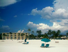 Beach (englishsnow) Tags: ocean summer vacation beach clouds umbrella hotel florida palmtrees whitesandbeach