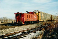 Southbound Grand Trunk Western Railroad freight train with a caboose rounding the interchange curve. Hayford Junction. Chicago Illinois. December 1988.