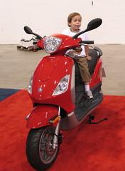 Boy on a red Vespa