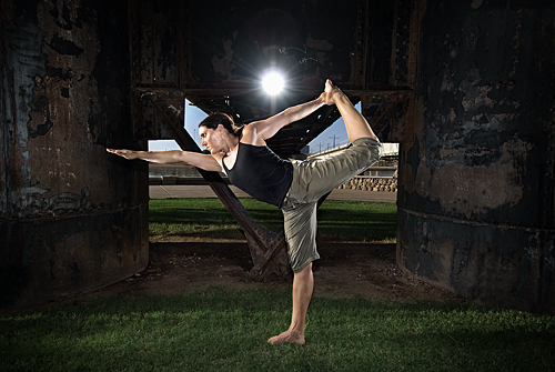 Yoga model posing beneath a bridge in Tempe Arizona
