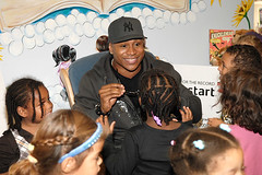 ll cool j smiling at a little kid