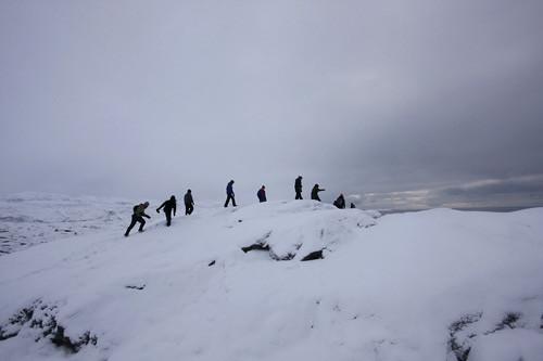 Hiking across a melting glacier overlooking Ilulissat Kangia