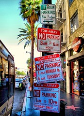 Sign of the Times (Ken Yuel) Tags: california losangeles noparking hollywood streetsigns hollywoodblvd trafficsigns signofthetimes takethebus doesntmakeanysense digitalagent noparkingtoday gladtobewalking hmmmmithinkihaveitnow