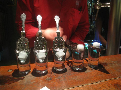 Preparing the absinthe shots