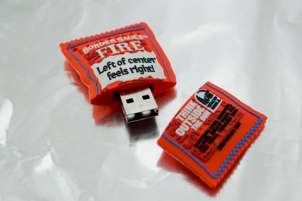 USB Flash Drive concealed in a hard plastic shell resembling a Taco Bell Hot Sauce packet