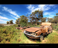 Seen Better Days :: HDR (:: Artie | Photography ::) Tags: broken car clouds trash photoshop canon gold garbage pieces cs2 wheels australia wideangle crack topless rubbish handheld newsouthwales scrapyard 1020mm bonnet hdr metals artie absolutly 3xp sigmalens photomatix tonemapping tonemap balranald trashedcar vegetations 400d rebelxti 20jaunary
