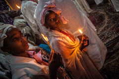 pilgrims celebrate fasika in the church Bet Medhame Alem.(easter) lalibela (anthony pappone photography) Tags: africa travel boy party portrait baby church girl beautiful festival kids night barn digital canon easter children religious photography photo photographer fiesta child faces photos bambini african picture iglesia best unesco portraiture childrens afrika enfants fotografia ethiopia orthodox celebrate ritratti blackgirl pilgrim celebrates reportage photograher lalibela afrique tradicion barna fasika eastafrica thiopien phototravel etiopia abyssinia ethiopie etiope  bambine afryka etiopija thiopie etiopien etipia religiouscross etiopi eos5dmarkii barnamyndataka  childrenbestphotos barnaljsmyndari barnamyndat betmedhamealem lens24105f4 churchbetmedhamealem