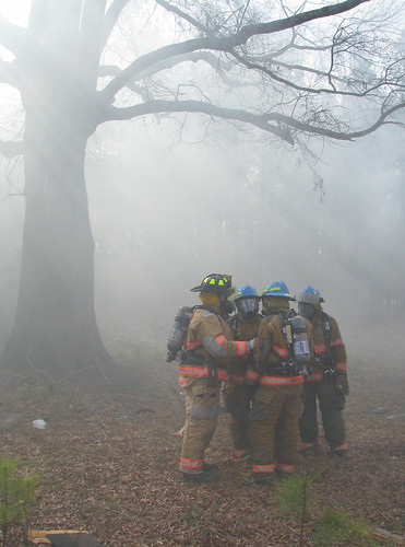 Firefighters in Grimm woods