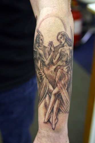 Angel-dancing-with-the-devil Tattoo by The Tattoo Studio