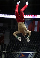 Fabian Leimlehner - high bar training 8 (roflmeter) Tags: red shirtless male college sports muscle ripped young hunk gymnast gymnastics fabian gym abs sixpack defined parallelbar pommelhorse highbar artisticgymnastics stillrings fabianleimlehner leimlehner
