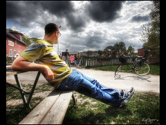 Watching the kids play (Kaj Bjurman) Tags: blue playing bike playground clouds eos sweden stockholm watching jeans norra hdr kaj hage cs3 bromma photomatix 40d ngby bjurman bjrklunds