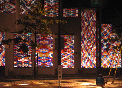 Sound of Light by the late Richard Elliott, as seen at night, lit up by the lights of passing cars. You can only see this artwork while traveling north on MLK. Photo by Wendi.