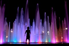 Wonder (Amanda SG) Tags: park blue boy shadow red summer playing color wet water fountain silhouette wall kids night austin lights downtown texas purple jets violet views interactive 1000 southaustin frosttower frostbanktower frostbuilding 3545 butlerpark townlakepark canonef2035 lizcarpenterfountain