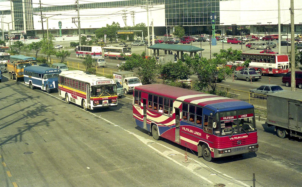 Vilfran Liner Nissan Diesel CPB87N NXZ-323 (fleet No 747120) and other buses in EDSA, Mandaluyong, Manila, Philippines.