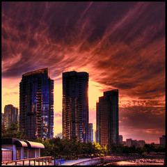 The day drains into a pool of gold (ecstaticist) Tags: sunset red cloud building silhouette yellow vancouver skyscraper gold casio trio hdr cloudscape wispy coa