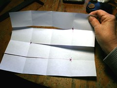 cutting a handmade folder