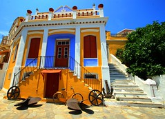 Nautical museum, Symi island (Marite2007) Tags: travel blue urban orange house color colour museum architecture facade season landscape greek islands site intense mediterranean place steps scenic entrance hellas vivid location architectural greece doorway staircase nautical picturesque symi flashy appearance neoclassical ellada dodecanese