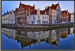 Bye Bye Bruges... for now (Nathan Bergeron Photography) Tags: homes light architecture sunrise reflections geotagged interestingness europe belgium brugge bluesky medieval symmetry canals unesco worldheritagesite symmetrical bruges oldworld