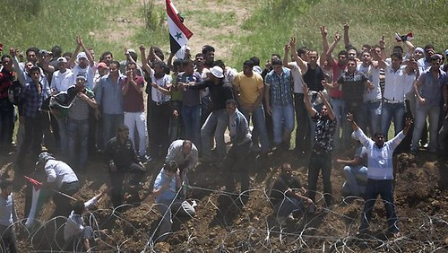 Palestinians in the Israeli-occupied Golan Heights demanding the right of return. Numerous Palestinians were reportedly killed on the border with Syria. by Pan-African News Wire File Photos