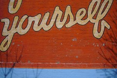 yourself (Made in Mississippi) Tags: blue orange brick sign wall word mural shadows script yourself atlantaga madeinmississippi